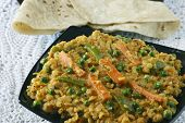 stock photo of ghee  - Sabzi dal made of arhar dal cooked with vegetables - JPG