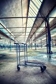 Old abandoned industrial interior with shopping card