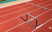 Single hurdle on red sports track