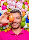 funny easter portrait of male with bunny ears
