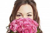 Female Bride Holding A Wedding Bouquet Of Pink Roses