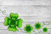 Four leaved clovers St Patrick background