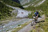 Mountain Biker Riding Though Swiss Mountain Area