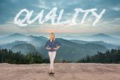 The word quality and thoughtful gorgeous blonde wearing classy clothes posing against scenic country