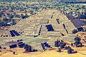 Vintage retro hipster style travel image of Pyramid of the Moon. View from the Pyramid of the Sun. T
