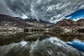 Sacred mountain lake Lohan Tso in Himalayas. Nubra valley, Ladakh, Jammu and Kashmir, India. High Dy