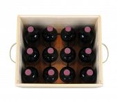 A wooden wine case with twelve bottles. High angle shot looking down into the wood crate. The box ha