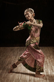 picture of mahabharata  - Vintage retro style image of young beautiful woman dancer exponent of Indian classical dance Bharatanatyam in Krishna pose - JPG