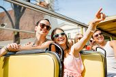 friendship, travel, vacation, summer and people concept - group of smiling friends traveling by tour