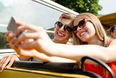 travel, vacation, technology, summer and people concept - smiling couple with smartphone traveling b