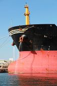 Bow Of Big Red Industrial Cargo Ship