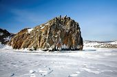 Rock on the bank of winter Baikal