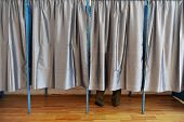 picture of voting  - A man casting his vote inside a voting booth - JPG