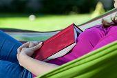 Woman Fell Asleep With Book On Hammock