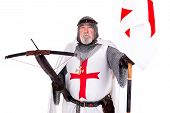 picture of templar  - Knight Templar posing with crossbow and flag isolated in white