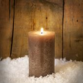 A Single Candle In Snow