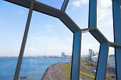 A view to Reykjavik coastline through the windows of Harpa Concert Hall