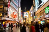 OSAKA, JAPAN - DEC 2: Unidentified tourists are shopping at Dotonbori on Dec 2, 2013 in Osaka, Japan. With a history reaching back to 1612, the districtis now one of Osaka's  tourist destinations.