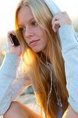 Beautiful Girl Sitting On The Roof And Listening To Music.
