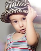 pretty boy with expressive eyes in a hat