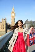 pic of westminster bridge  - London woman tourist shopping bag near Big Ben - JPG