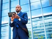 african american businessman using tablet