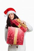Shocked woman opening christmas present on white background