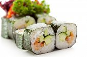 Japanese Cuisine - Sushi Roll with Shrimps and Cucumber inside, Nori outside. Served with Parsley, Salad Leaf and Shrimps