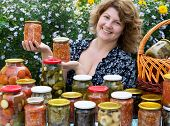 Woman With Home Canning For The Winter