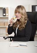 Attractive Businesswoman Drinking Water