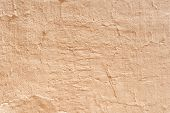 Ocher concrete wall textured background.
