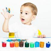 little cute boy learns to draw fingers
