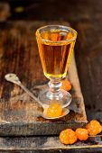 cloudberry liqueur with berries