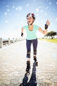 Fit mature woman rollerblading on the pier against snow falling