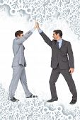 Unified business team high fiving each other against snowflakes on silver