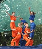 Mstyora,Russia-August 16,2014: Young girls in bright suit execute acrobatic exercises on scene at da