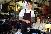 Waiter And  Costumer At The Restaurant With Copy Space