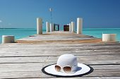 Hat and sunglasses on the wooden jetty. Exuma, Bahamas