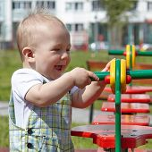 kid playing on playground