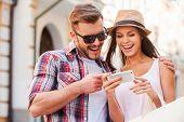 Happy Couple With Smart Phone.