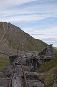 image of hatcher  - Top view of deteriorating trestle bridge with building at Independence Mine - JPG