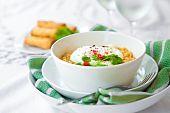 Oriental noodles with poached eggs, chili and coriander leaves