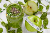 stock photo of mason  - Apple and spinach green smoothie in mason jar - JPG