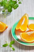 Slices of Orange and mint leaves