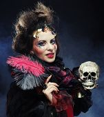 Picture a beautiful fantasy woman with skull. Halloween theme. Party theme.