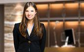 image of receptionist  - Smiling female receptionist - JPG
