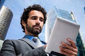 Portrait of a businessman using a tablet computer