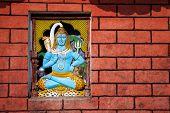 image of shiva  - Shiva statue on brick wall in Hindu temple Sarangkot Nepal - JPG