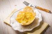 risotto with saffron on cheese bowl