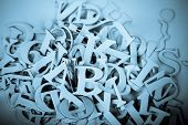 abstract background of  Latin letters. Blue toned with selective focus